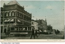 Image of Businesses along North Broadway Street, Peru, Indiana, ca. 1915 - Seen in this photo are the First National Bank, a street car, the Gerhart and Dyball Art Studio, a candy shop, and the Peru Trust Company.