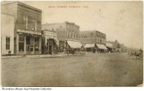 Image of Stores on Main Street, Kirklin, Indiana, ca. 1910 - The B. H. Gorman and Searcy Drug Store are seen.