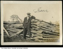 Image of Man named Sam by a rustic wood fence, Indiana, ca. 1910 - This unmarked photo was part of a group of images from the Indianapolis Marion County area.