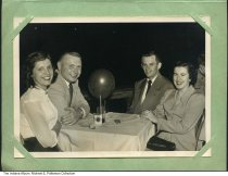 Image of Two couples at the Indiana Roof, Indianapolis, Indiana, 1952 - L to R: Margie and Robert Patterson, and Don and Ginny Edwards on May 28, 1952. The back of the photo shows the dance floor of the Indiana Roof, and is autographed by Ralph Flanagan.