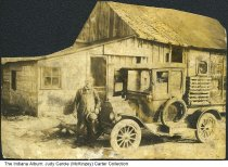 "Image of Valandingham Neff Jones and his truck, Pine Village, Indiana, ca. 1925 - ""Grandpa"" Valandingham Neff Jones (b. July 11, 1864 in Newtown, Ind. died December 12, 1934 Pine Village Ind.) is seen with his Model T truck by the Beatrice Creamery in Pine Village. He married Lydia Elma Smith on September 5, 1883. Lydia was born May 5, 1864 and died December 6, 1936 in Pine Village."