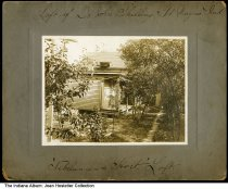 """Image of Pigeon loft of Dr. John Shilling [Schilling], Fort Wayne, Indiana, ca. 1915 - Written on the front of this photo is """"Loft of Dr. John Shilling, Ft. Wayne, Ind. - 'Nibelungen = Hort.' Loft."""" The pigeon loft is on on the house's roof.  Dr. John Schilling was known for racing pigeons and broke many world records for 1,000 mile flights in the early 1900s. This may be the backyard of Schilling's home and office at 432 East Washington Boulevard."""