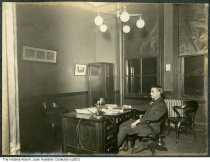 Image of A man in an office, Central Union Telephone Company, Indianapolis, Indiana, 1907 - Another photo in this bound album shows a calendar dated December 1907.