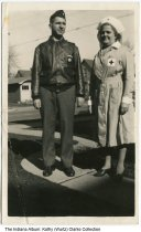 Image of Elizabeth and Ray Wurtz in uniform, Indianapolis, Indiana, 1942 - Elizabeth Wurtz, is seen in a Red Cross uniform. Ray Wurtz (left) wears a leather bomber jacket and a military-style cap.