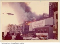 Image of Fire in the old Grant building in downtown Indianapolis, Indiana, 1973 - Also seen in this image are Roslyn Bakery, Christian Science Reading Room, Central Beauty College, Wesleyan Book Room, and Arsenal Savings and Loan Association.
