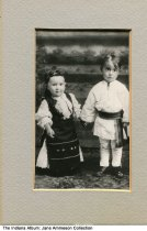 Image of Dan and Mary Simon as children, Indiana Harbor, Indiana, ca. 1915 - Dan Simon and his sister, Mary in Indiana Harbor. Their parents imigrated from Romania; the years from 1900 to 1920 saw around 20,000 Romanian immigrants move to the steel manufacturing city.
