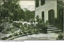 Image of Neuronhurst, Dr. W. B. Fletcher's Sanatorium, Indianapolis, Indiana, ca. 1910 - Image shows the side of one of the buildings and a flower garden. The sanatorium, known as Neuronhurst after 1904, was a private hospital for the treatment of nervous and mental diseases. It was located on the northwest corner of North Highland Avenue and East Market Street.