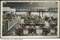 Image of Interior of McCammon's Pharmacy, Indianapolis, Indiana, ca. 1931 - Postmarked February 24, 1931. Pharmacist Bert C. McCammon built the McCammon Building on the northwest corner of College Avenue and Maple Street (now East 38th Street) in 1922 and 1923 to house his pharmacy, other stores, and upstairs apartments.