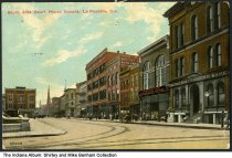 Image of South side of the Courthouse square, Lafayette, Indiana, ca. 1911 - Signs can be seen for Farmers & Traders Bank, F. W. Woolworth 5 and 10 cent store,  Challis' Shoe Store, Dewerter & Co., and American Express Co. Postmarked May, 1911.