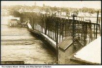 Image of Flood waters by a bridge and Red Wharf Co., Lafayette, Indiana, March 1913