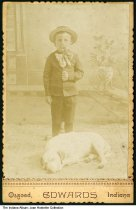 Image of Boy posing with a sleeping dog, Osgood, Indiana, 1890 - Dated July 1890 on the back.