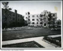 Image of Lockfield Gardens Apartments, Indianapolis, Indiana, June 1937 - Stamped June 1937 on the back. On the back is typewritten information about the housing complex.
