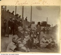 """Image of Purdue University baseball team, Indiana, 1899 - A group of young men in baseball uniforms are seated by bleachers. The caption reads """"Purdue team, '99.""""  Other images are numbered ia-0001-1026 through ia-0001-1034."""