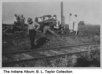 Image of Automobile and train accident, Columbus, Indiana, ca. 1940 - The accident took place at Gladstone two blocks south of State Street. A car was hit by a train, and a family was killed.