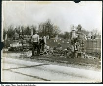 """Image of Men working on a cemetery fence, Lake County, Indiana, ca. 1950 - Stamped """"Saidla Photo"""" lower left corner."""