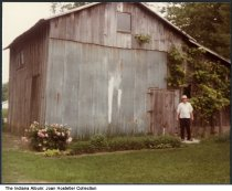 """Image of Russell Barnhart in back of his barn, Pierceton, Indiana, 1984 - Written on the back is """"Russell Barnhart 70 yrs. in back of his Barn that's 100 yrs old, July 1984."""""""