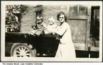 """Image of Beatrice Nichols and her children, Indiana, ca. 1925 - Written on the back is """"Children Betty Rose 2 yr? less, Lee Jr. 6 mo? Mom Beatrice Nichols 23"""" years, Pantsy the dog. Lee's old dray line truck, delivered things frm Depo (sic) to Merchants.""""  May be related to other photos identified as Kosciusko County."""
