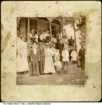 """Image of Gerber family in front of their home, Dubois County, Indiana, ca. 1900 - On the back is written """"Some kind of big day at Grandfather Gerber's house."""" One of thiose pictured, Peter Gerber, was born in 1844 and died on February 7, 1934."""