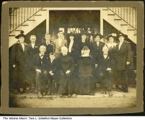 "Image of Group at Father Beno's Silver Anniversary Celebration, Dubois County, Indiana, ca. 1910 - On the back is written ""Fr. Beno's SIlver Anniv. Front row: Peter Gerber, Gerald Uebelhor, Fr. Beno Gerber O.S.B, , Sister Hildegarde O.S.B, John Gerber. Back row: Susan Uebelhor (b. 1878), Anton Gerber, Jacob Gerber, Alois Gerber, his wife Thresia Gerber Thresia Kluek, Thresia Gerber, Tonys daughter Regena Gerber & Mrs. John Gerber's wife Mary.""  