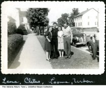 """Image of 2 men in uniform with two women, Indiana, ca. 1943 - The caption reads """"Leona (or Lena), Cletus, Levona (Leona?), Urban (?). """" One man is in a Navy uniform."""