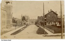 Image of Buildings along 6th Street, Logansport, Indiana, ca. 1895 - A large building, possibly a church or a school, is seen on the left.