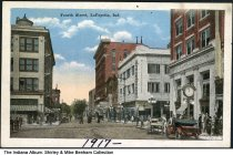 Image of Businesses along 4th Street, Lafayette, Indiana, ca. 1917 - Dated 1917. The Lafayette Loan and Trust Company and The Baltimore are seen, along with automobiles and pedestrians.