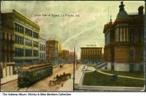 Image of South side of the square, Lafayette, Indiana, ca. 1912 - Postmarked May 21, 1912. The Tippecanoe County courthouse, The Fair, and the W. H. Zinn Company are seen, along with streetcars and horse wagons.