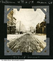 """Image of Snow on Main Street, Mount Vernon, Indiana, ca. 1917 - The caption reads """"Between 4th & 5th Main Street, 1917-1918 snow."""""""