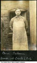 "Image of Ben Isham in a work apron, Mount Vernon, Indiana, ca. 1928 - The caption reads ""Ben Isham back of Craft Shop."""