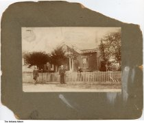 """Image of Four people and a dog in front of a house, Indianapolis, Indiana, ca. 1875 - Written on back is """"Grandfather & mother with father & mother - Beatlore (Blatlace? Blatlove?) Homestead""""."""