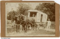 "Image of Peddler and his horse cart, Indiana, ca. 1890 - Written on the back is ""William W. Cox/Ben Davis Indiana/about 1890."" The cart is marked ""Dry goods & Groceries"" and has a sign inside the door for Hulman's Coffee."