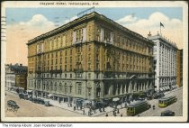 Image of Hotel Claypool, Indianapolis, Indiana, ca. 1921 - Postmarked September 12, 1921. Pedestrians, cars, and streetcars are seen in front of the hotel.