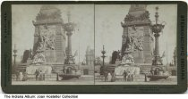 Image of Group at the Soldiers' and Sailor's' Monument, Indianapolis, Indiana, ca. 1900 - Five people are seen by the waterfall by the Peace Group of statues on the monument.