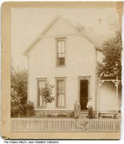 Image of A young women and a girl in front of a house, Anderson, Indiana, ca. 1890 - This left half of a stereoview is from the American View Company of Anderson, Ind.