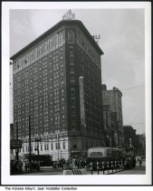 Image of Snapshot of the Hotel Lincoln, Indianapolis, Indiana, ca. 1940 - Signs can be seen for Hook's Drugs,  Barney's Diamonds, Fairway Furniture, People's, Livingston's, Kirk, Ideal.