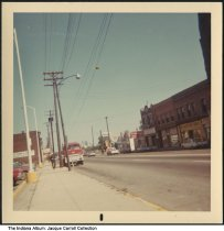 """Image of Haughville businesses, Indianapolis, Indiana, ca. 1990 - Written on the back is """"Haughville near Grandma Duffin's grill."""" The area is in the area of 2615 West Michigan Avenue."""