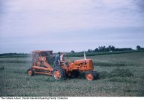 Image of Men operating a tractor at the Wabash County Fair, Wabash, Indiana, ca. 1960 - Two men work with an Allis Chalmers tractor and mower.