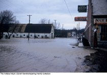 Image of Flooded street by the Farm Co-Op Bureau, Wabash, Indiana, ca. 1960