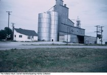 Image of Grain elevator and railroad crossing, Wabash, Indiana, ca. 1960 -