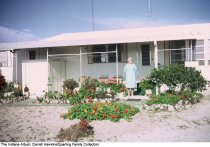 Image of Woman in front of a ranch style home, Wabash, Indiana, ca. 1960 -