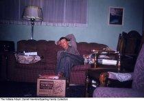 Image of Man asleep around Christmas gifts, Wabash, Indiana, ca. 1960 -