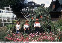 Image of Children in cowboy outfits in a garden, Wabash, Indiana, ca. 1960 -