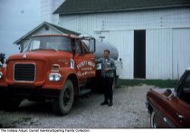 "Image of Man with a large truck, Wabash County, Indiana, ca. 1960 -  The truck reads ""Everett Hodge, Marion, Ind.""."