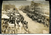 Image of Horse show crowd on Main Street, Mount Vernon, Indiana, ca. 1915 - The photo was taken at 4th and Main Streets looking south. Seen are the Everetson Block building, a grocery store advertising pears, a hardware and paint store, and a drugstore. The horse show was the last in Mount Vernon.