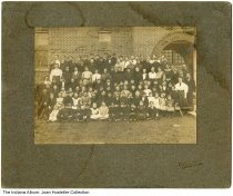 "Image of Children and teachers in front of a school, North Manchester, Indiana, ca. 1905 - The mat on the photo has a stamp in the lower right that reads ""Gills Shults (?), N. Manchester, Ind."""