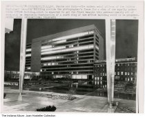 """Image of Newly constructed buildings by the State House, Indianapolis, Indiana, ca. 2004 - A photo and press release shows the newly constructed Indiana Employment Security Building. It is dated 11/19, it may be from 2004 as the number in front of it reads """"111704""""."""