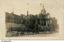 Image of Aftermath of a building fire, Frankfort, Indiana ca. 1910 - Postmarked May 9, 1910. The Clinton County Courthouse appears to be in the background.