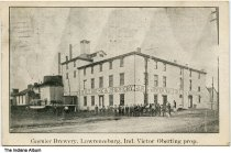 """Image of Garnier Brewery, Lawrenceburg, Indiana ca. 1907 - Postmarked November 14, 1907. Workers are seen outside of this large brewery that has a sign reading """"J. B. Garnier Malt House & Brewery."""""""