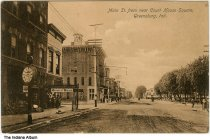 Image of Businesses on Main Street, Greensburg, Indiana, ca. 1910 - Signs can be seen for Little's Lunch Room, Muth's Bread, a dentist's office, and the Hub (?) Boots & Shoes.