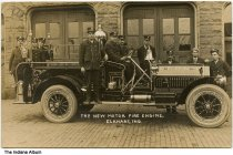 """Image of Motor fire engine at Central Fire Station, Elkhart, Indiana, ca. 1911 - Ten firefighters in uniform are seen with the new motor fire engine, marked """"EFD No. 1"""". Postmarked March 10, 1911."""